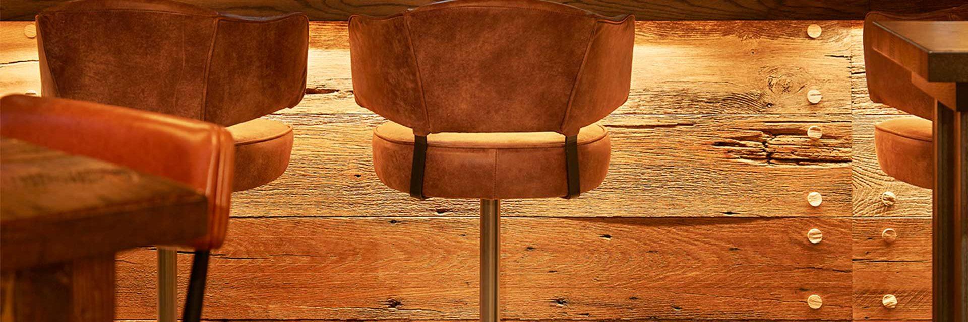 brown bar stool with metal base