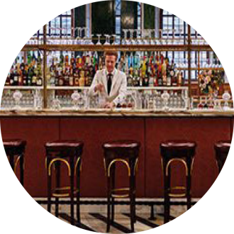 man at bar with stools