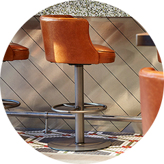 Brown leather bar stool on metal base