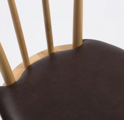 Beech ply-formed stacking side chair brown seat close up