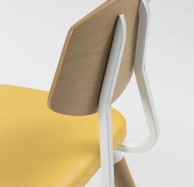 Side chair with steel frame and yellow wooden seat yellow close up back