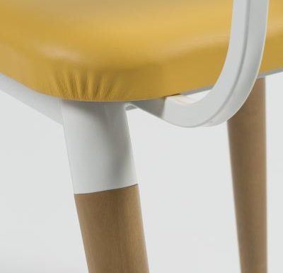 Side chair with steel frame and yellow wooden seat yellow close up seat
