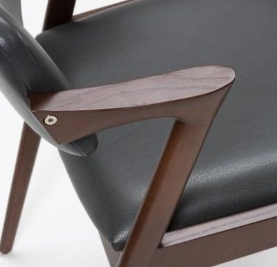 Beech leg frame armchair close up