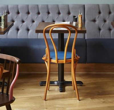metal side chair with seat pad blue by table