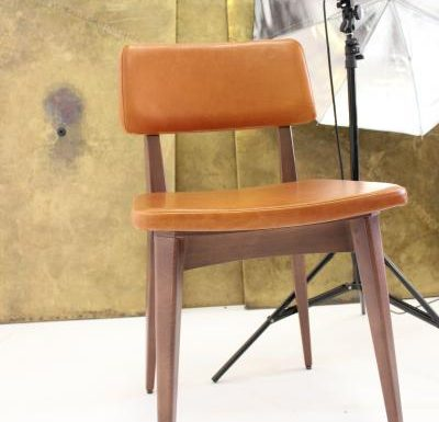Black and white and gold and black beech side chairs orange front