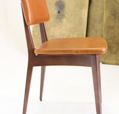 Black and white and gold and black beech side chairs orange side