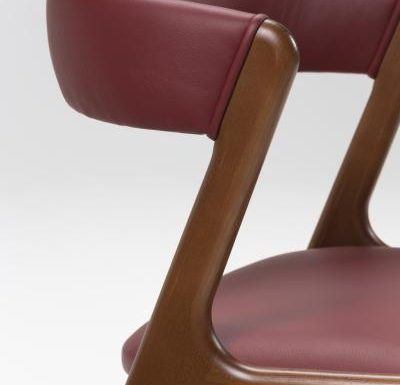 Wooden side chair with red upholstery close up
