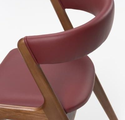 Wooden side chair with red upholstery side view