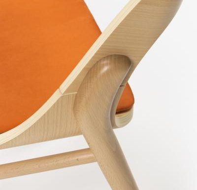 beech leg frame side chair light upholstery close up