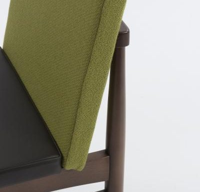 mid century style upholstered sidechair close up