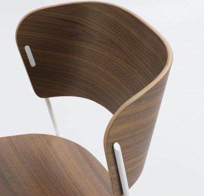 A classy sled base chair with bent ply formed shell back and seat close up