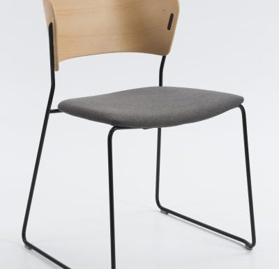 A classy sled base chair with bent ply formed shell back and seat - side view metal