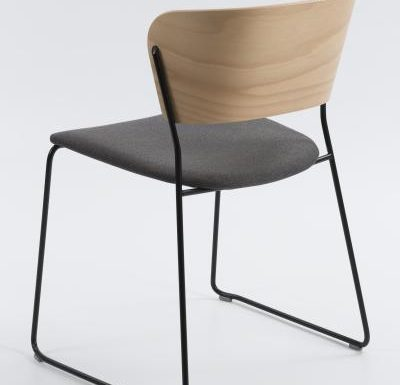 A classy sled base chair with bent ply formed shell back and seat - rear view metal
