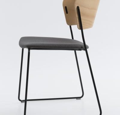 A classy sled base chair with bent ply formed shell back and seat side view black