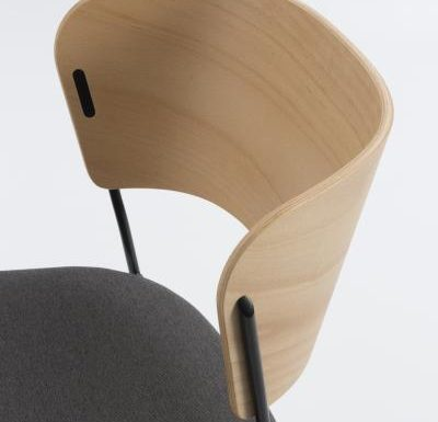 A classy sled base chair with bent ply formed shell back and seat close up black