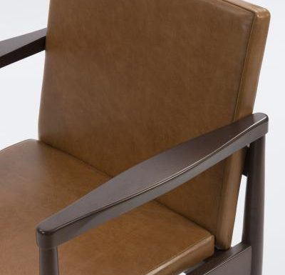 mid century design upholstered armchair with a wooden frame - close up view